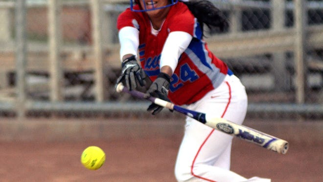 Las Cruces High's Amber Saiz lays down a perfect bunt during first inning action Mayfield Tuesday night at Field Of Dreams Softball Complex.