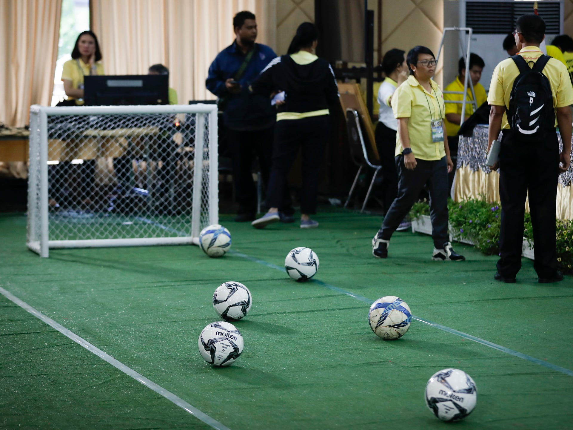 A mini soccer field being set up before a press conference