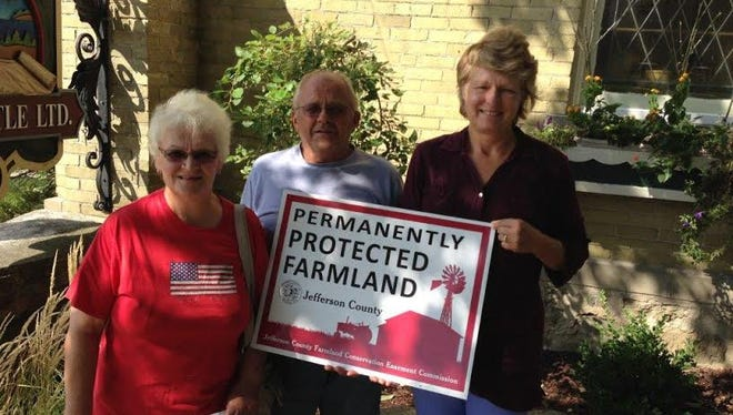 Cliff and Sue Haberman have preserved their farm for agriculture through the Jefferson County PACE program. With them is the representative of the PACE program and Jefferson County Land and Water Conservation Committee Margaret Burlingham.
