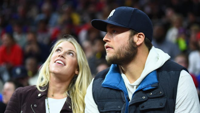 Lions quarterback Matthew Stafford with wife Kelly Stafford during the game between the Detroit Pistons and the Cleveland Cavaliers on Nov. 17, 2016, at the Palace.