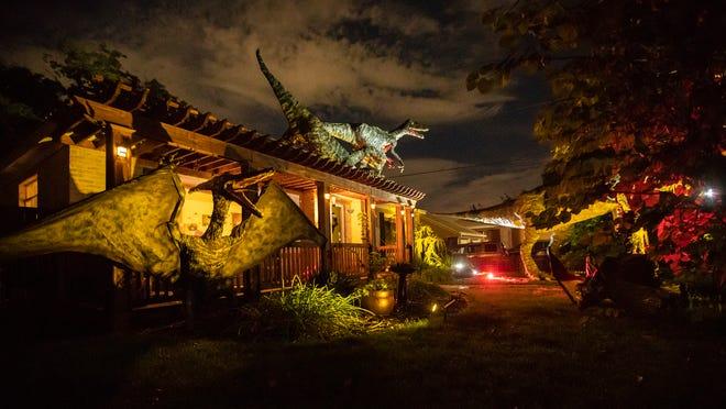 Dinosaurs decorate Ammon Smith's Salt Lake City yard for Halloween on Wednesday, Oct. 3, 2018.