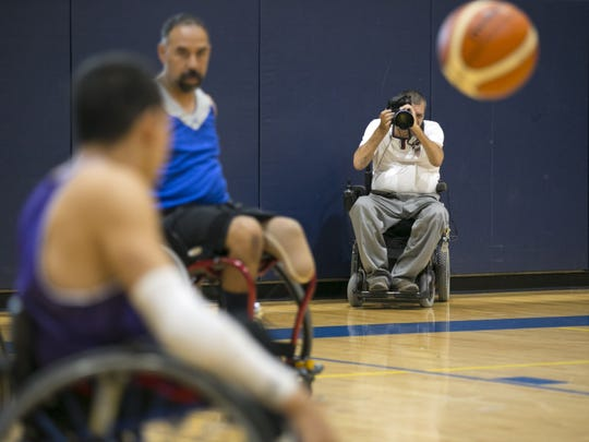 Loren Worthington photographs an Ability 360 wheelchair basketball practice at the Ability360 Sports & Fitness Center in Phoenix on Sept. 1, 2016. Worthington is currently in Rio, photographing the Paralympic Games.
