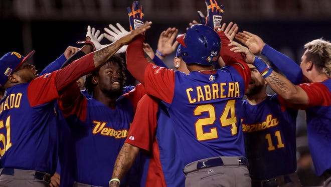 Venezuela's Miguel Cabrera celebrates with teammates after hitting a run against Italy during the ninth inning of a tie-breaker game at the World Baseball Classic in Guadalajara, Mexico, March 13, 2017.