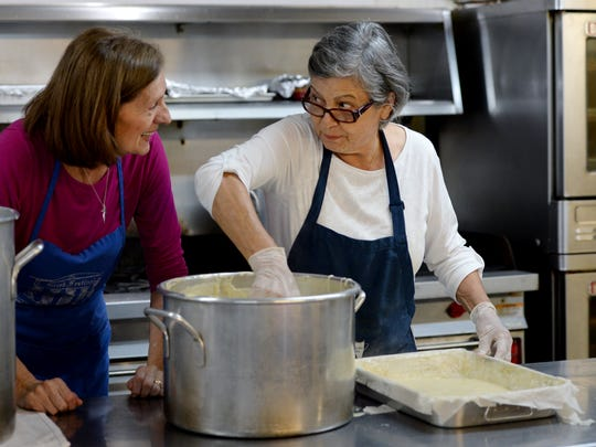 Maria Como, right, and Pauline Giannopoulos, left, along with other women of St George Greek Orthodox Church make traditional Greek pastries on Wednesday in preparation for the Greek Pastry Sale.