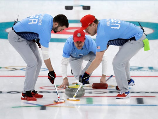 United States's skip John Shuster, center, launches the stone during their men's curling semi-final match against Canada at the 2018 Winter Olympics in Gangneung, South Korea, Thursday, Feb. 22, 2018. United States won. (AP Photo/Aaron Favila)