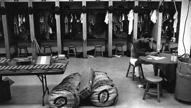 APRIL 5, 1979: Reds' workout...Coach Russ Nixon plays cards in the deserted locker room.