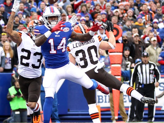 A pass from Buffalo Bills quarterback Kyle Orton, not pictured, intended for wide receiver Sammy Watkins (14) is deflected before Cleveland Browns defensive back Jim Leonhard (30) intercepted the throw during the first half of an NFL football game, Sunday, Nov. 30, 2014, in Orchard Park, N.Y. Cornerback Joe Haden (23) help defend on the play. (AP Photo/Gary Wiepert)