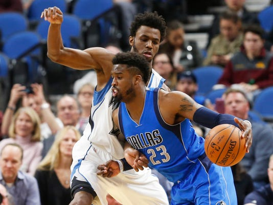 Dallas Mavericks' Wesley Matthews, right, drives around Minnesota Timberwolves' Andrew Wiggins during the first half of an NBA basketball game Friday, Feb. 24, 2017, in Minneapolis. (AP Photo/Jim Mone)