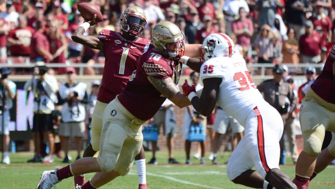 Despite the loss, Florida State freshman quarterback James Blackman (1) had a solid debut, going 22 for 38 with 278 passing yards and touchdown.