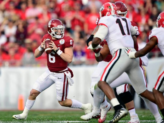 January 1, 2018; Pasadena, CA, USA; Oklahoma Sooners quarterback Baker Mayfield (6) looks for an open man to pass to against the Georgia Bulldogs during the first half in the 2018 Rose Bowl college football playoff semifinal game at Rose Bowl Stadium. Mandatory Credit: Gary A. Vasquez-USA TODAY Sports