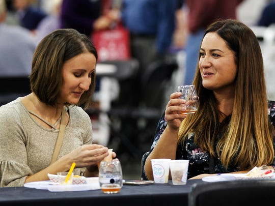 Nikki Wnuk (left) and Cecilia Kopecky, both of Greendale, sample foods at The Journal Sentinel Food & Wine Experience.