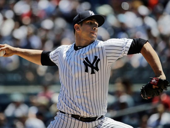 Luis Cessa delivers a pitch against the Rangers Saturday