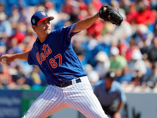 New York Mets pitcher Seth Lugo throws during the first