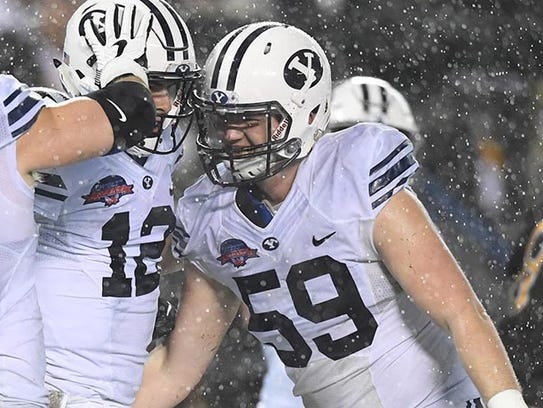 Brigham Young Cougars lineman Thomas Shoaf (59)  went