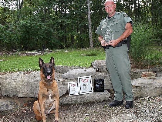635774998568657896-Sgt-Robin-Curtis-and-Rocky-K-9-Team