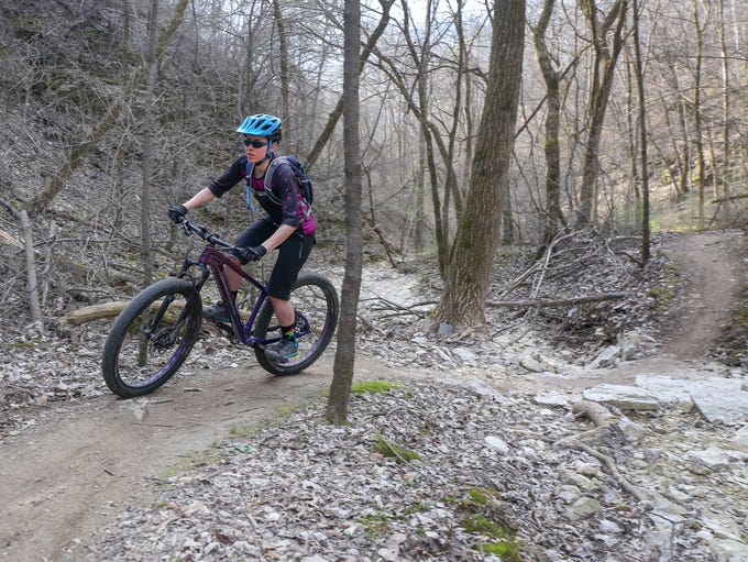 Josie Smith of Decorah weaves her mountain bike between