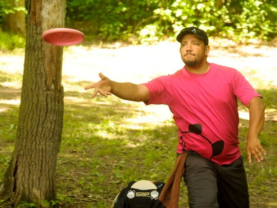 Chris Dickerson of Milwaukee, Wis., plays disc golf at Rollin' Ridge in Reedsville during the 2014 Silver Cup Disc Golf Tournament on Friday. The tournament blends three Manitowoc County disc golf courses, Silver Creek in Manitowoc, Rollin' Ridge in Reedsville and Lower Cato Falls in Cato. Two tournament rounds on Saturday plus one round on Sunday for professional and advance players. For more information go to www.silvercupdiscgolf.com. Sue Pischke/HTR Media. Photo taken on Friday, June 27, 2014.