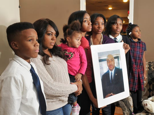 Many families in Detroit must cope with the slaying of a family member. Marcel Jackson was killed while working as a security guard, leaving behind, from left, Tarik, 13; wife Hollie holding Aaliyah, 2; Jala, 16; Najidah, 18; Tamia, 13; and Gwendolyn, 7.