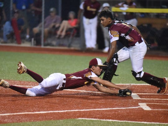 Eagle Pass, Texas, pitcher Luis Kancheff makes a diving