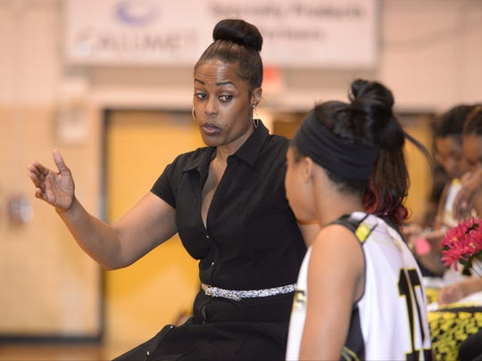 Fair Park coach Cherise Sims talks with Deborah Ford before putting her in against Ben Franklin in the Lady Indian's first round class 4A state playoff game.