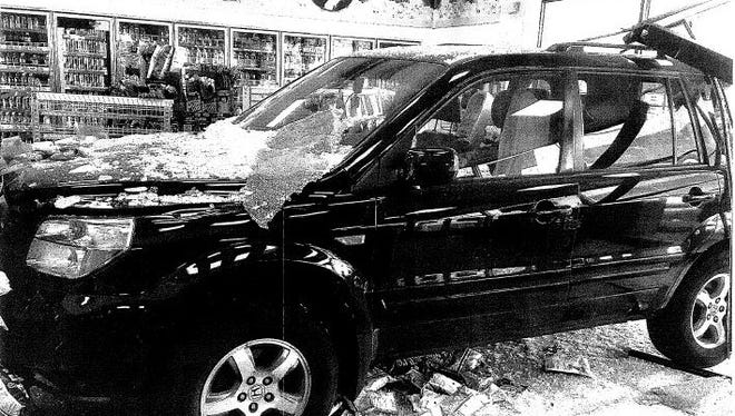 A Honda Pilot driven by John Tierney crashed into the On the Run convenience store Sunday. Black and white photo taken from police report.