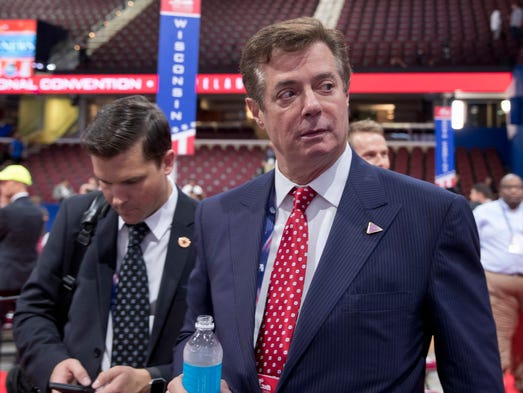 Manafort walks around the convention floor before the