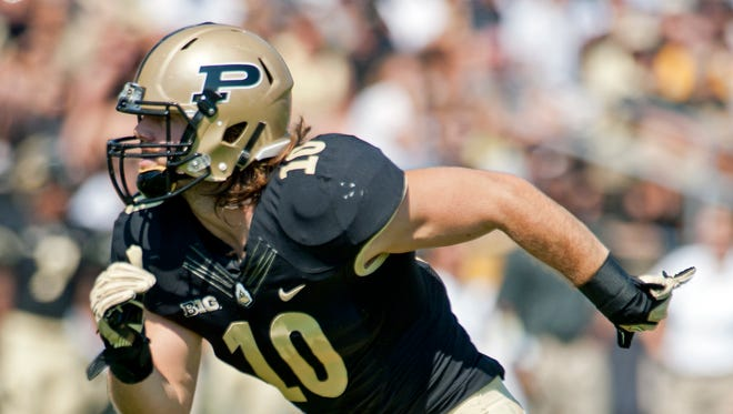 Sean Robinson played quarterback as a freshman before making the move to linebacker.