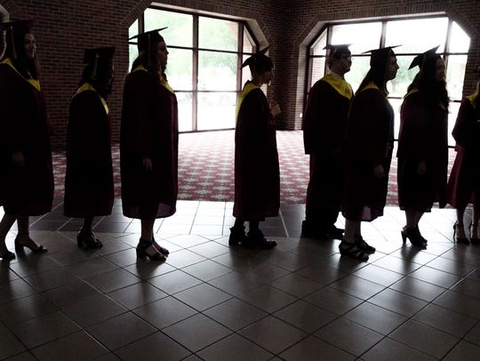 Students are silhouetted against a window before the