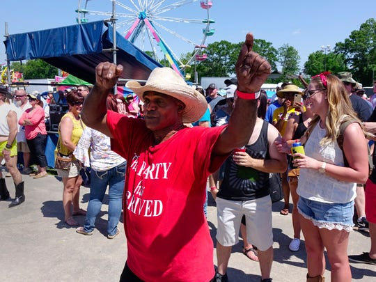 "Joe ""Wild Man' Potier puts on his Zydeco moves at the Breaux Bridge Crawfish Festival Sat, May 6, 2017."