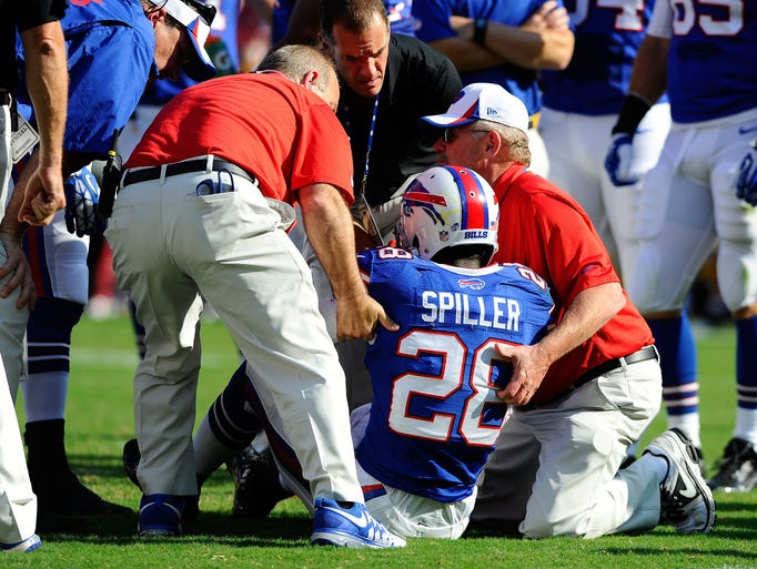Buffalo Bills running back C.J. Spiller (28) is tended to by team trainers after scoring a touchdown against the Washington Redskins
