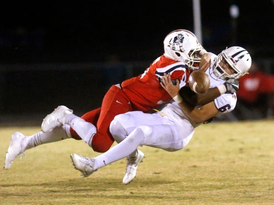 Oakland's Aaron Moore sacks Cookeville quarterback Cade Smith during a 2017 playoff game.
