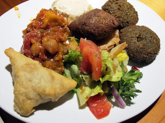Menu items include falafel, kibbeh, baba ghanoush, fatayer spinach, eggplant salad and hummus at Kareem's Lebanese Kitchen in February next to 21 Spices in Sugden Park Plaza off U.S. 41 East in East Naples.
