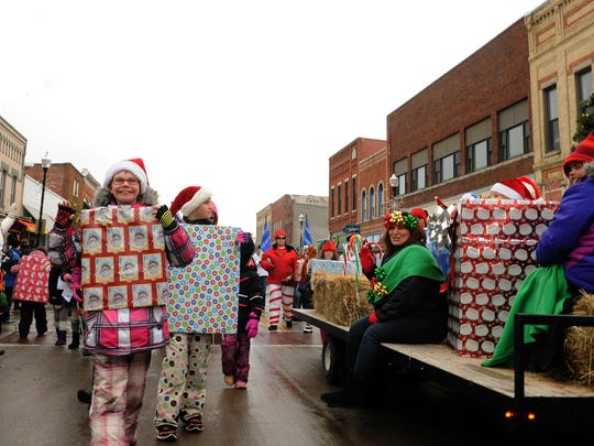 """Local Girl Scout troops provided extra holiday spirit by marching as brightly wrapped presents during last year's Holiday Parade at """"Christmas By the Bay"""" in Sturgeon Bay."""