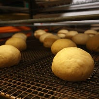 The freshly rolled dough for paczki are ready to be baked for the next day's sales at Louie's Donut Shop on East Columbia Avenue in Battle Creek.
