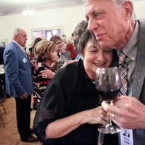 Carol (Pietrangelo) Wilson and Chris Potter greet one another during the Wauwatosa West class of 1966 reunion.  About 80 alums signed up to attend the 50th anniversary meet-and-greet at the Wauwatosa Woman's Club on Sept. 24.