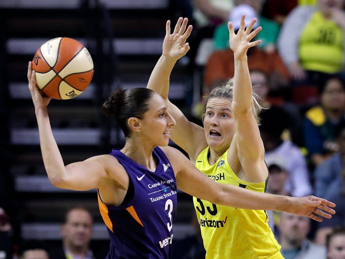 Seattle Storm's Sami Whitcomb, right, defends against