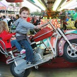 Duncan Magers on the motorcycle ride at All Saints Superfest last year. The carnival return on Sept. 25.