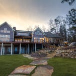 Chad Stearns Builder installed sliding barn doors to the bedroom of this rustic Lake Martin home.