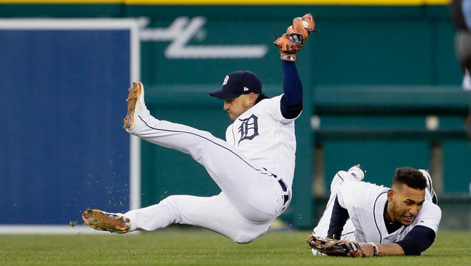 Tigers shortstop Jose Iglesias falls to the ground after colliding with left fielder Victor Reyes, after catching a fly ball hit by Gregory Polanco of the Pirates during the fifth inning of Game 2 of a doubleheader at Comerica Park on Sunday.