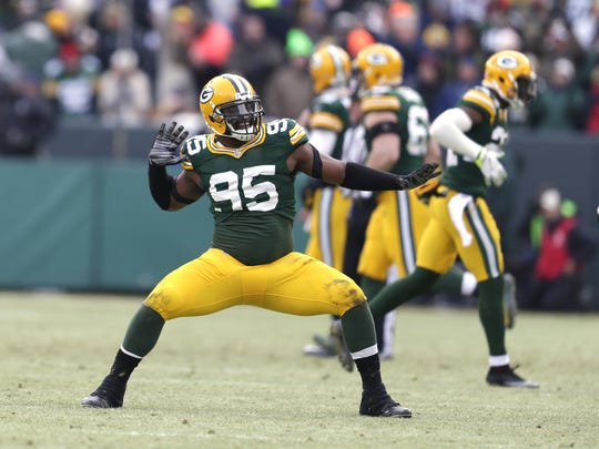Green Bay Packers Datone Jones (95) celebrates his