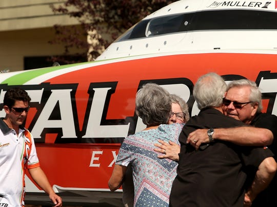 Anne (left) and Darrell Louden (far right) hug Kyler Talbot's mother and stepfather, Marcia and Richard Josephsen.