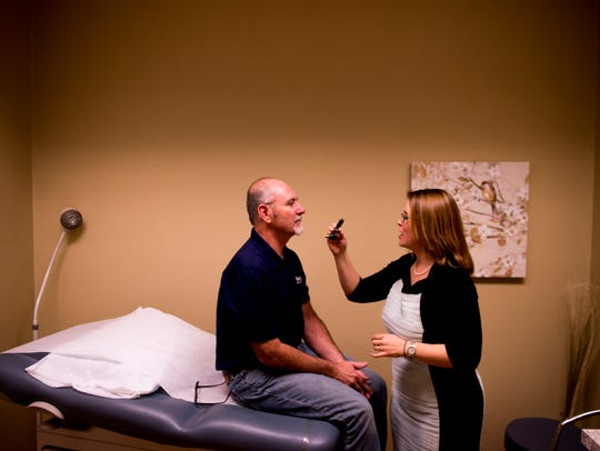 Dr. Erin E. Chambers asks patient Michael Hopkin to