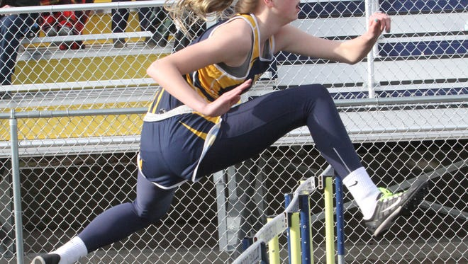 Kenzie Mantz clears a hurdle for Belle Plaine in the shuttle hurdle relay.