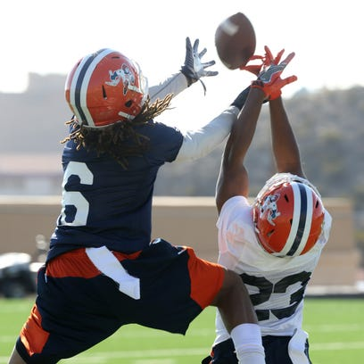 UTEP's Brandon Moss, left, and Justin Rogers battle