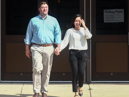 State Sen. Bryan Townsend, D-Newark, walks with wife Lilianna at Glasgow High School after voting in the Tuesday primary.