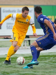 Nashville SC forward Robin Shroot tries to get past