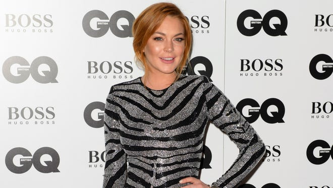 Lindsay Lohan arrives for the GQ Men Of The Year Awards 2014 in central London. A Los Angeles judge on Wednesday Jan. 28, 2015, set another court hearing in Lohan's reckless driving case after a prosecutor questioned whether the actress had completed the terms of her community service sentence with a London charity organization.