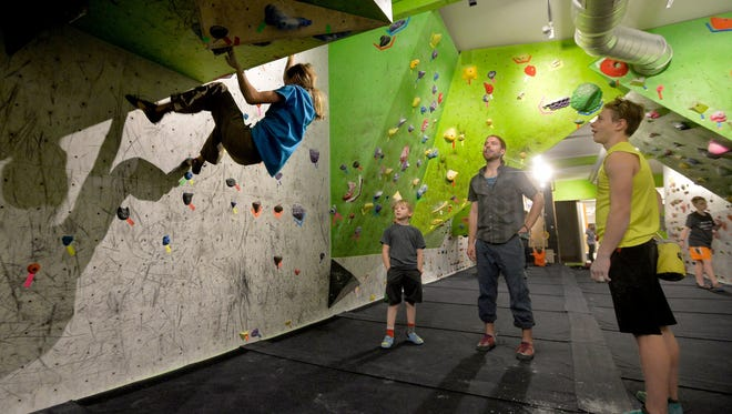 Christian Buhler, age 13, watches Hi-Line Climbing teammate, Layla Kerr, practice at the Hi-Line Climbing Center.