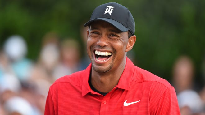 Sep 23, 2018; Atlanta, GA, USA;  Tiger Woods reacts after winning the Tour Championship golf tournament at East Lake Golf Club. Mandatory Credit: John David Mercer-USA TODAY Sports