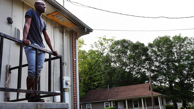 """In this Thursday, May 26, 2016 photo, Brandon White stands on the balcony of his former home in the Atlanta neighborhood where in February 2012, a group of young men yelling gay slurs attacked him in Atlanta. """"For them to say there were no hate crimes in February, we know that isn't true,"""" says White, 24. """"That there makes it harder to trust the police."""" (AP Photo/Christina Almeida Cassidy)"""